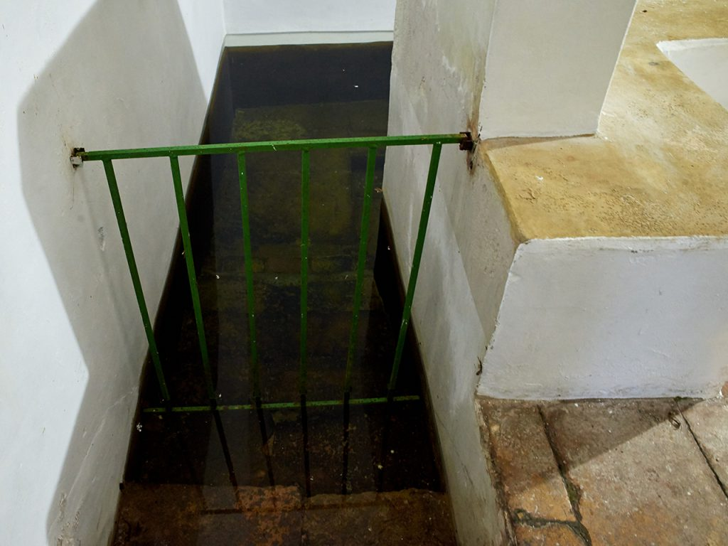 Mikveh, stairs into water pool.